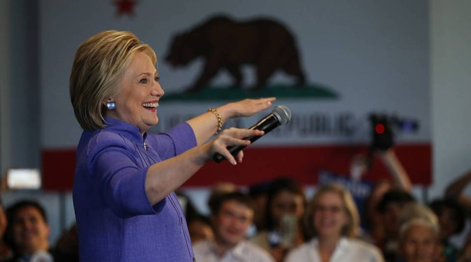 """""""I don't think there's nearly as much uncertainty about Clinton"""" because she's """"predictable,"""" says Nicholas Bloom of Stanford University. Above, the Democratic presidential candidate speaks at an event on Friday in Westminster, California."""