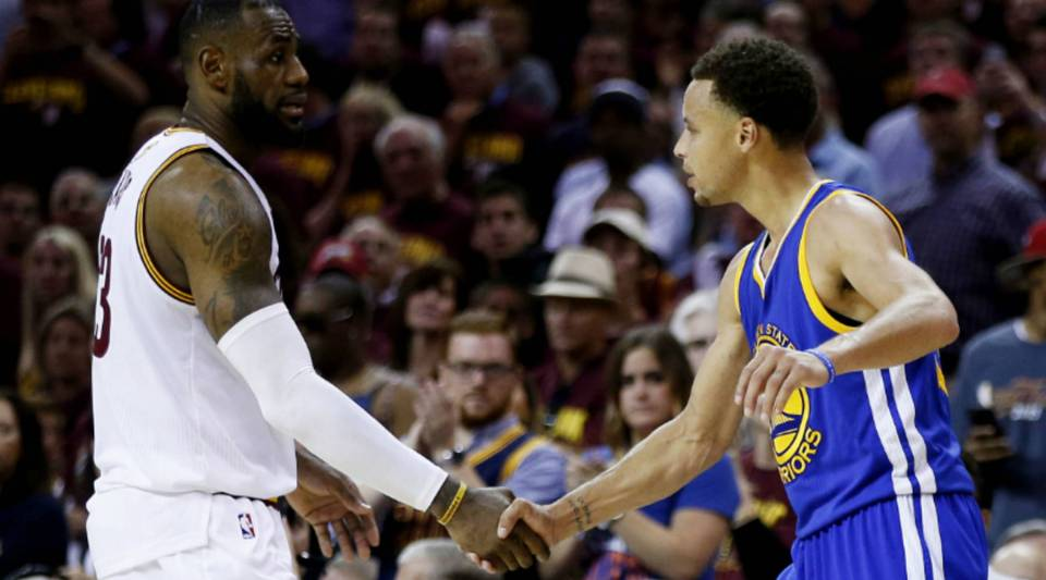 LeBron James of the Cleveland Cavaliers shakes hands with Stephen Curry of the Golden State Warriors after the Warriors defeat the Cavs to win Game 6 of the 2015 NBA Finals at Quicken Loans Arena last year.