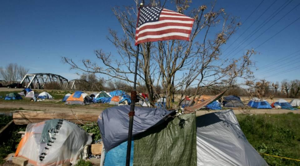Homeless tents line a field in Sacramento, California.