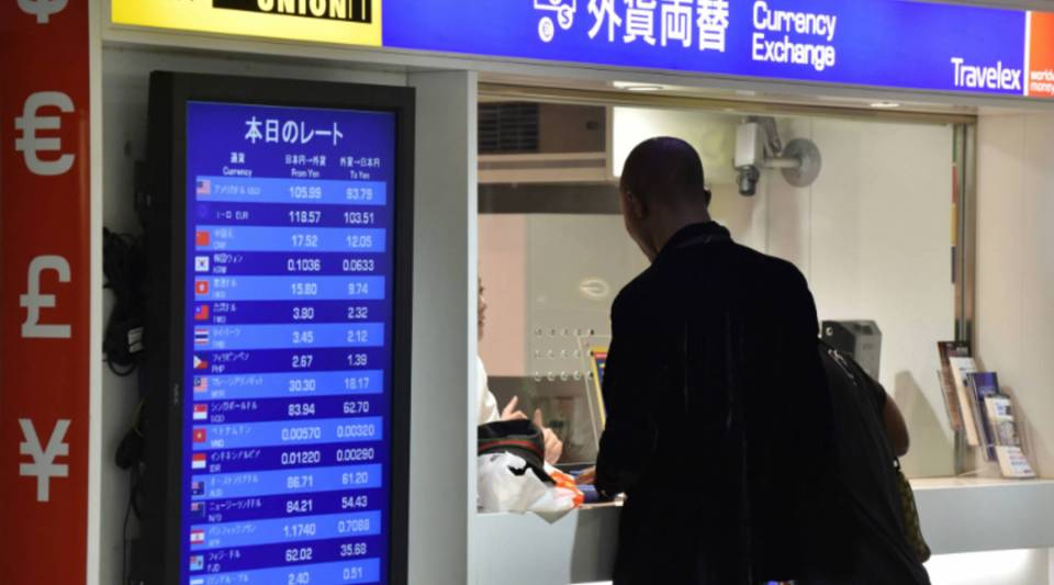 People visiting a foreign exchange office in Tokyo on Friday. Japanese Finance Minister Taro Aso pledged on Friday that Tokyo is ready to adopt strong measures to address wild volatility on financial markets driven by Brexit fears.