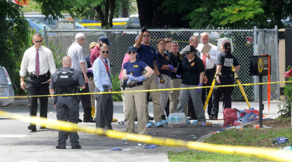 FBI agents are seen outside of Pulse nightclub, the spot of the nation's deadliest mass shooting in modern history. Nearly 50 people are reported dead and at least that many more are injured.