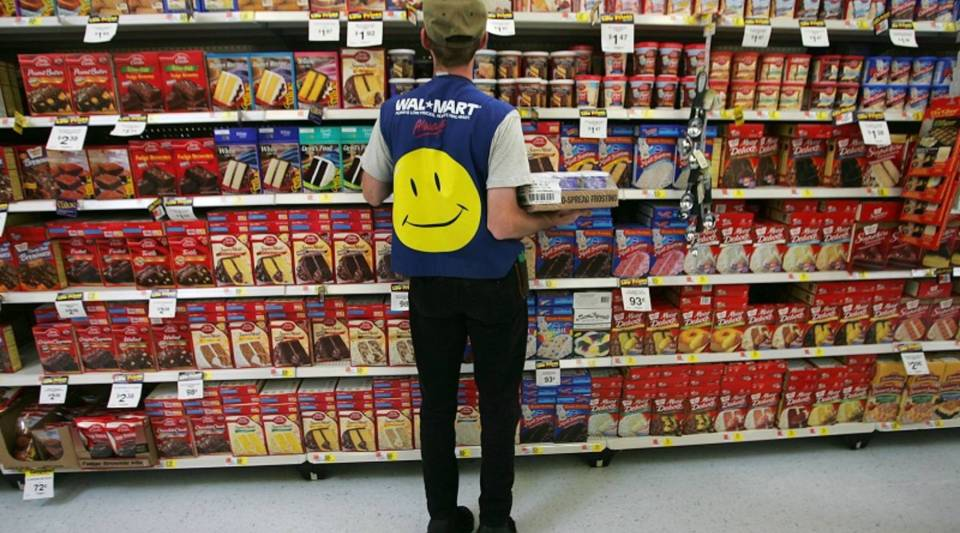 Wal-Mart is bringing back its low-cost icon, the yellow smiley face.