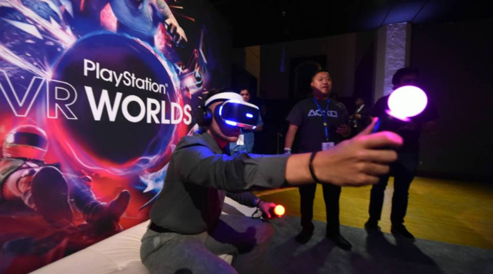 People try the new Sony VR headset at a Sony PlayStation E3 event in Los Angeles, California on Monday.