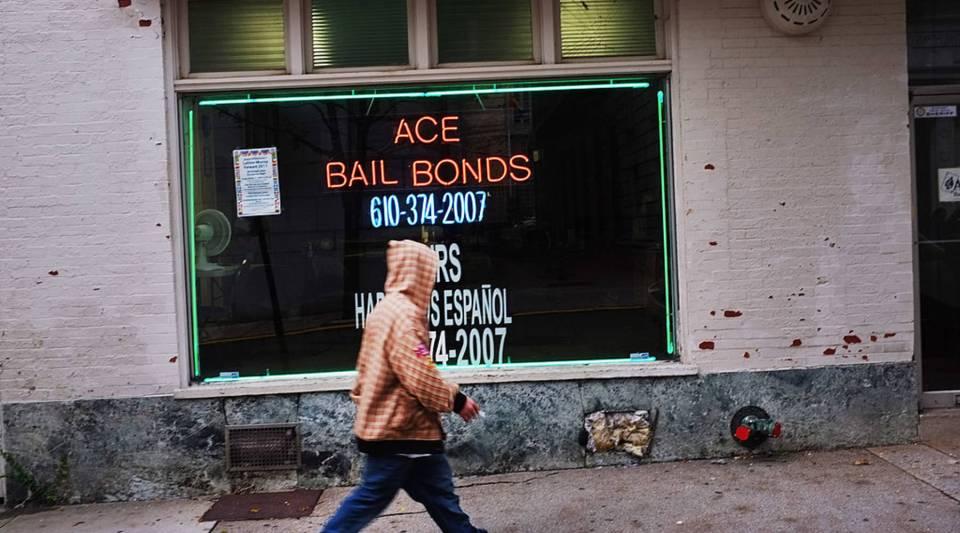 A man walks by a bail bonds shop in Reading, Pennsylvania.