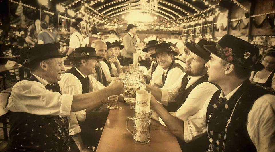 Men in their traditional Bavarian clothing clink beer mugs on the second day of the 2014 Oktoberfest at Theresienhoehe on Sept. 21, 2014 in Munich, Germany.