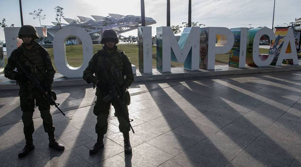 Brazilian marines stand guard at the Maua square in downtown Rio de Janeiro, Brazil on July 9, 2016, ahead of the Rio Olympic Games.
