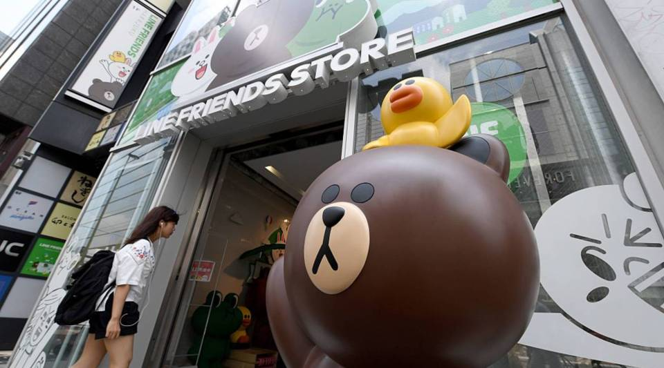 This photo taken on July 12, 2016 shows a customer entering the Line Friends shop in Tokyo's Harajuku district. Japan-based messaging app Line kicks off a dual New York-Tokyo stock listing later on July 14, 2016 after one of the year's biggest initial public offerings. The company, looking to expand on booming popularity among smartphone users in Asia, priced its shares at a top-of-the-range 3,300 yen (32 USD), suggesting strong demand for the sale.