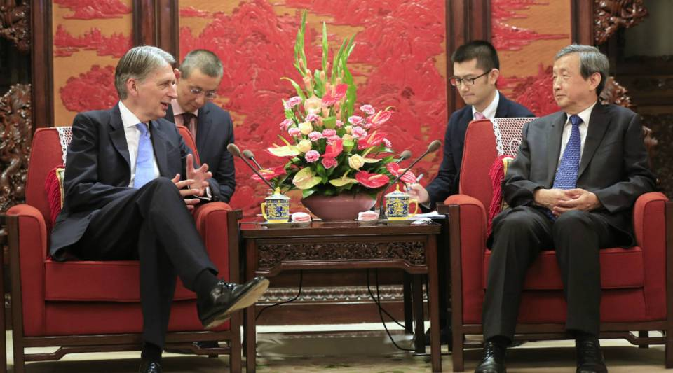 Britain's Chancellor of the Exchequer, Philip Hammond, left, speaks with Chinese Vice Premier Ma Kai during a meeting in Beijing on Friday. Hammond is in China to attend the G20 Finance Ministers meeting in Chengdu, besides visiting Beijing and Hong Kong to promote British business opportunities.