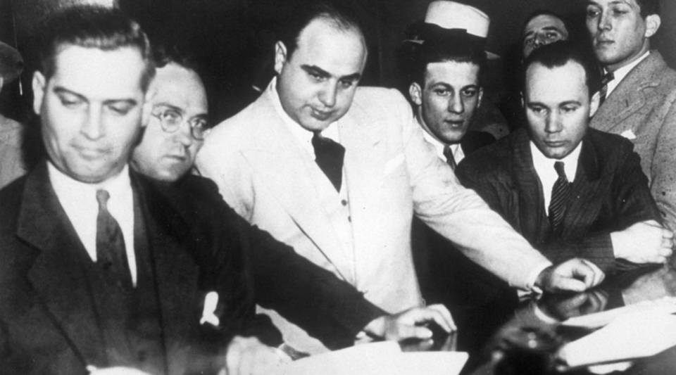 American gangster Al Capone signs a $50,000 bail bond in Chicago's Federal Building.