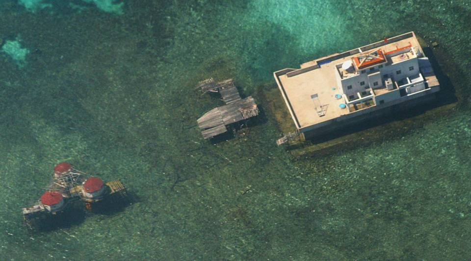 This aerial photograph, taken from a Philippine aircraft, shows Chinese-built structures on the Mischief Reef in the disputed Spratly islands strategically located in the South China Sea.