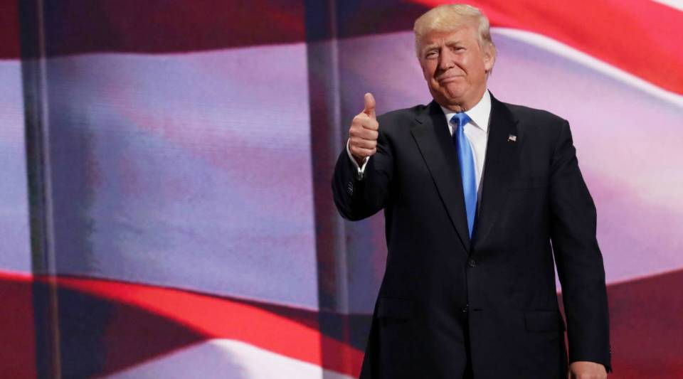 Presumptive Republican presidential nominee Donald Trump gives a thumbs up to the crowd after his wife Melania delivers a speech on the first day of the Republican National Convention at the Quicken Loans Arena in Cleveland, Ohio.