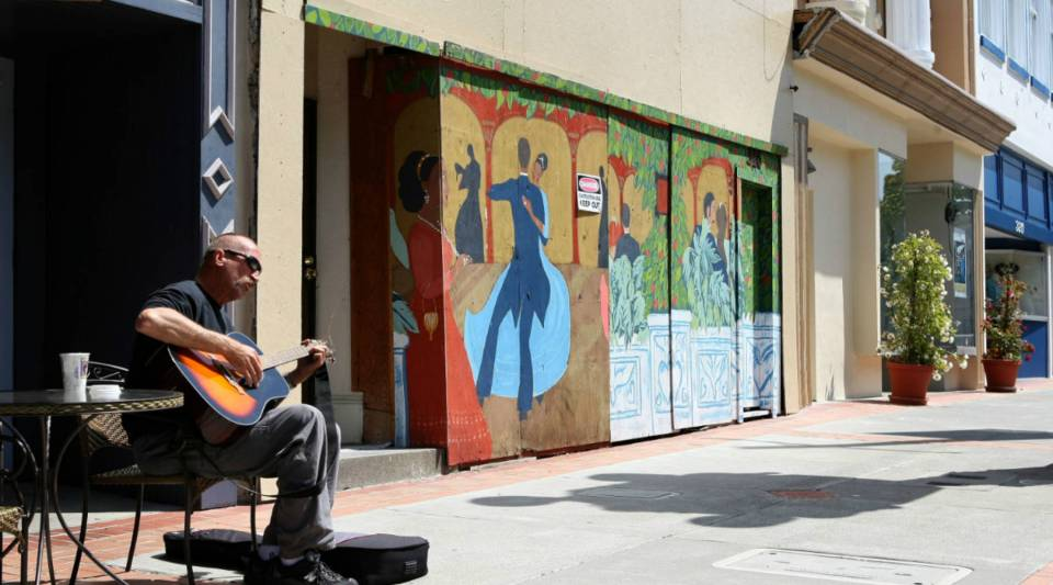 A man plays his guitar in front of a cafe on Georgia Street in the historic section of Downtown Vallejo in Vallejo, California.