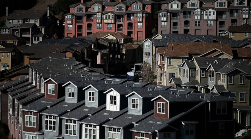 Rows of homes line a street in a housing development in Oakland, California.