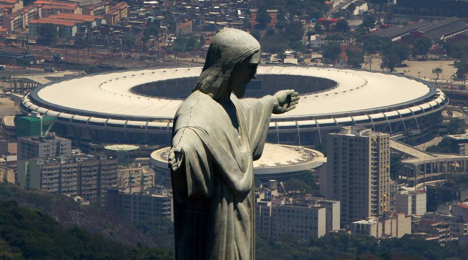 An aerial view of the Christ The Redeemer statue (F) and the Maracana Stadium (B) on November 12, 2013 in Rio de Janeiro, Brazil.