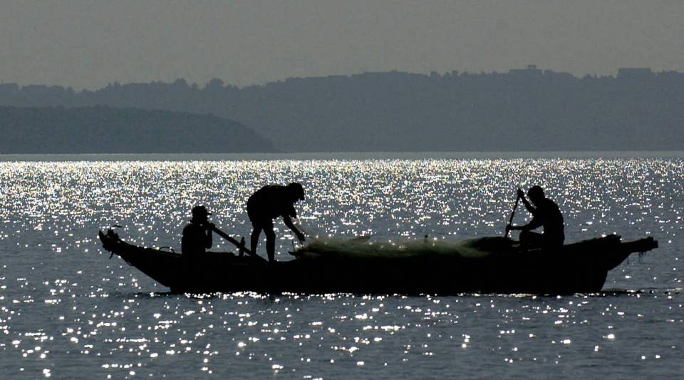 Idian fishermen put out their nets in anticipation of a big catch on the glistening waters near a beach at Goa, renown for its seafood.