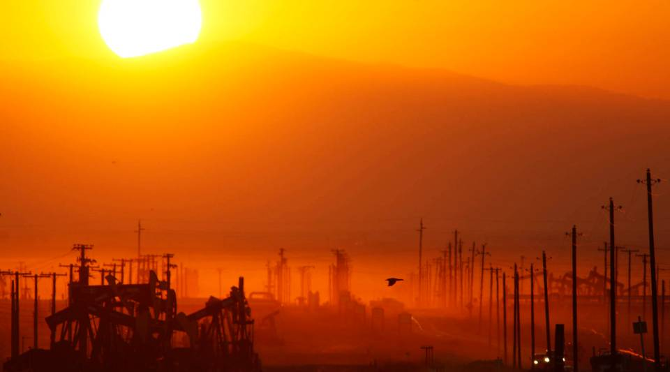 The sun rises over an oil field used for hydraulic fracturing in California.