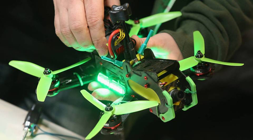 A drone racing enthusiast prepares a racing drone at the 2016 CeBIT digital technology trade fair on March 14, 2016 in Hanover, Germany. First-person view drone racing, in which the pilot wears goggles to give him the live view from a camera mounted on the drone, is growing rapidly in popularity with racing leagues in many different countries.