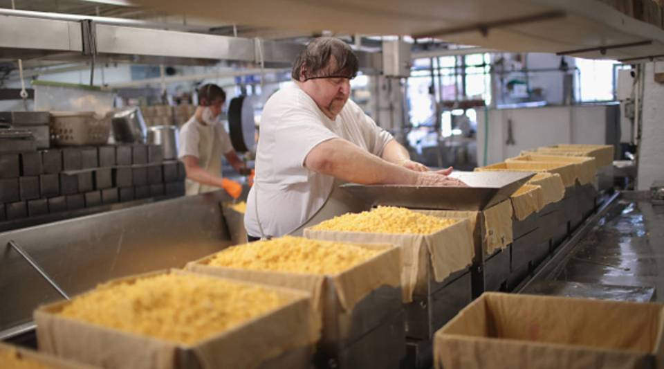 Lenny Zimmel puts Colby cheese curds into forms to make 40 pounds blocks of cheese at the Widmer's Cheese Cellars on June 27, 2016 in Theresa, Wisconsin. In 2015, Americans were consuming over 34 pounds of cheese per capita.