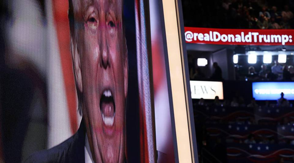 A screen displays Republican presidential candidate Donald Trump delivering his speech during the evening session on the fourth day of the Republican National Convention on July 21, 2016 at the Quicken Loans Arena in Cleveland, Ohio.