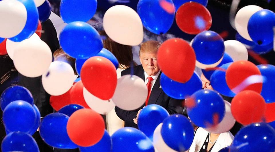 Republican presidential candidate Donald Trump and his family acknowledge the crowd as balloons fall on the fourth day of the Republican National Convention on July 21. Trump announcedhis economic advisory team today.