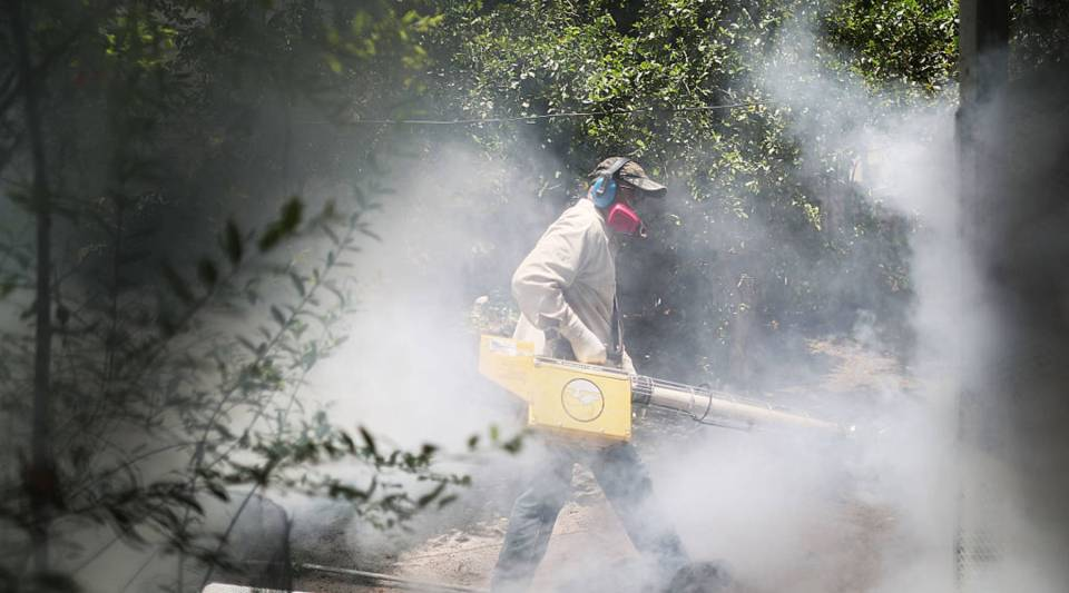 Carlos Varas, a Miami-Dade County mosquito control inspector, uses a Golden Eagle blower to spray pesticide to kill mosquitos in the Wynwood neighborhood as the county fights to control the Zika virus outbreak on August 2, 2016 in Miami, Florida. There is a reported 14 individuals who have been infected with the Zika virus by local mosquitoes. (Photo by Joe Raedle/Getty Images)