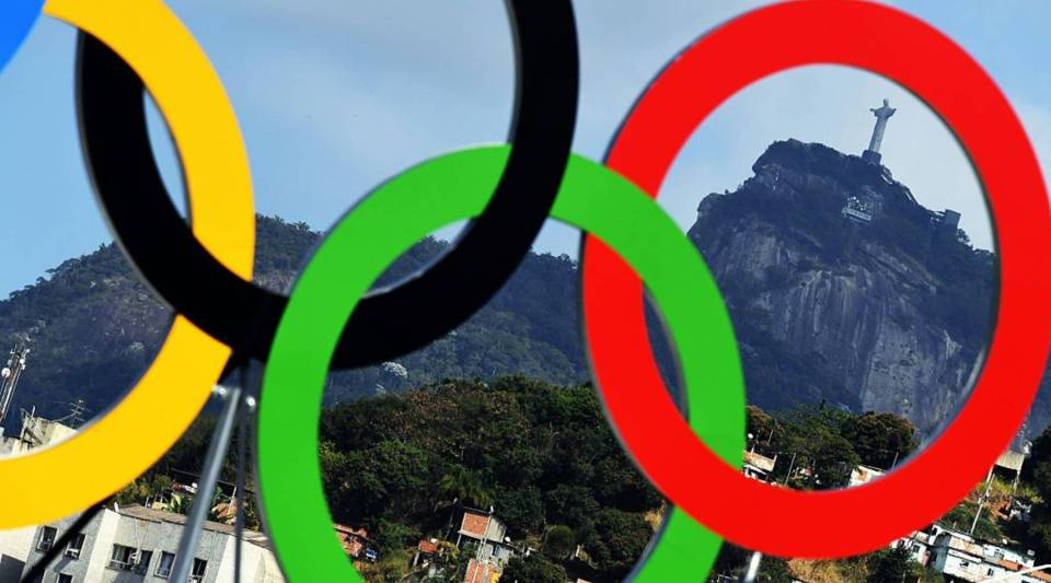 The Christ the Redeemer statue is seen through a set of Olympic rings at the Sambodromo archery venue in Rio de Janeiro on Thursday.