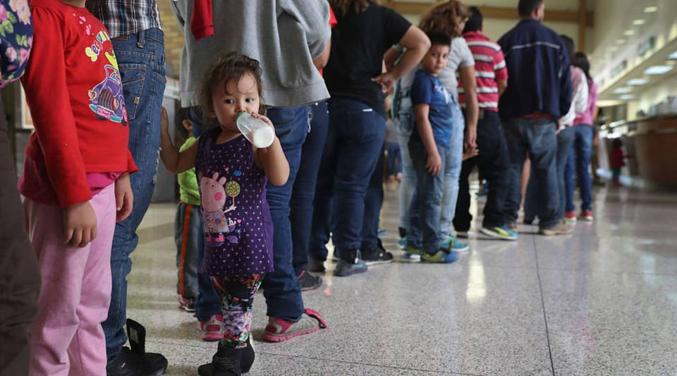 Immigrant families stand in line to get bus tickets in McAllen, Texas, shortly after crossing the Rio Grande.