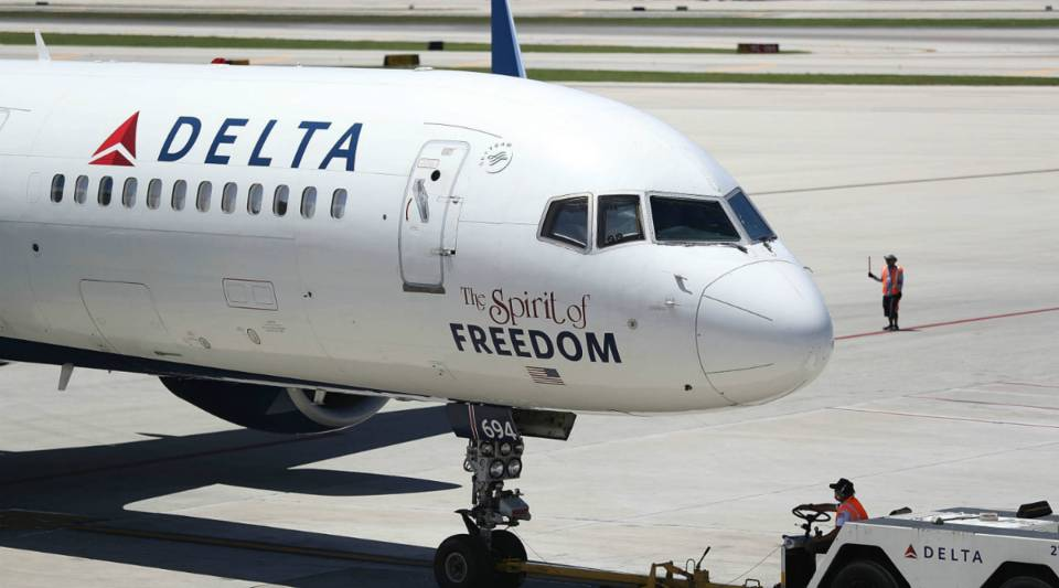 A Delta airlines plane is seen on the tarmac of the Fort Lauderdale-Hollywood International Airport in July in Fort Lauderdale, Florida.