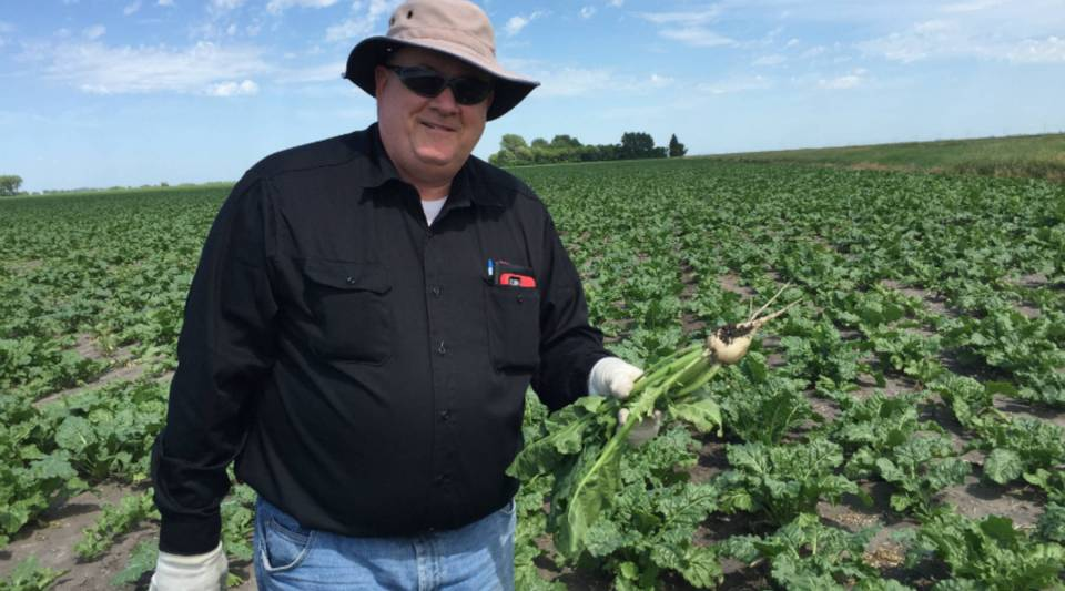 Farmer Bill Hejl in Amenia, North Dakota says switching to genetically modified sugar beets has lowered his overall herbicide use and his carbon footprint, as he has to run machinery over his fields less often to manage weeds.