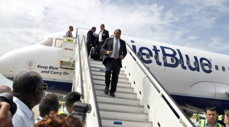 U.S. Transportation Secretary Anthony Foxx (front), deplanes upon arriving at the airport of Santa Clara, Cuba on the first commercial flight between the United States and Cuba since 1961.