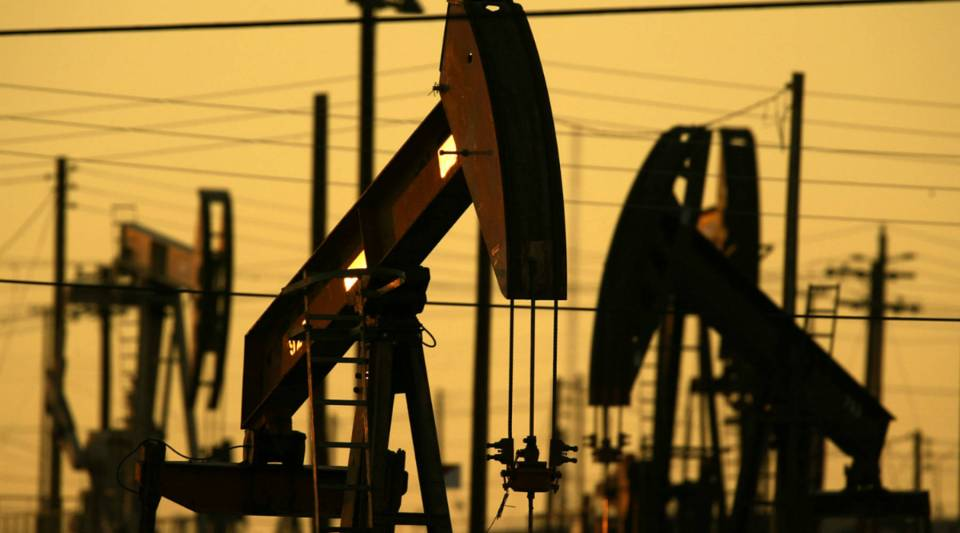 Oil wells pump the oil fields of California's southern Central Valley.
