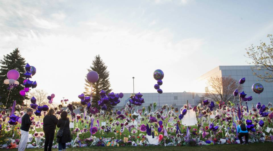 Music fans visit a memorial created outside Paisley Park, the home and studio of Prince.