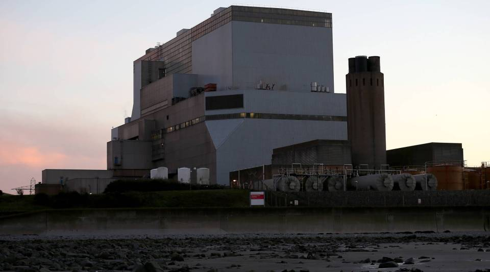 The sun sets behind Electricite de France SA's (EDF) Hinkley Point B nuclear power station besides the Bristol Channel near Bridgwater on November 12, 2013 in Somerset, England.