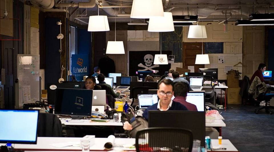 Start-up employees working at a tech incubator.