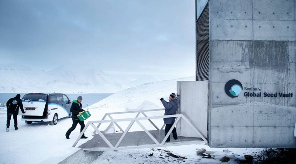 A man carries one of the newly arrived boxes containing seeds from Japan and USA into the international gene bank Svalbard Global Seed Vault, outside Longyearbyen on Spitsbergen, Norway.