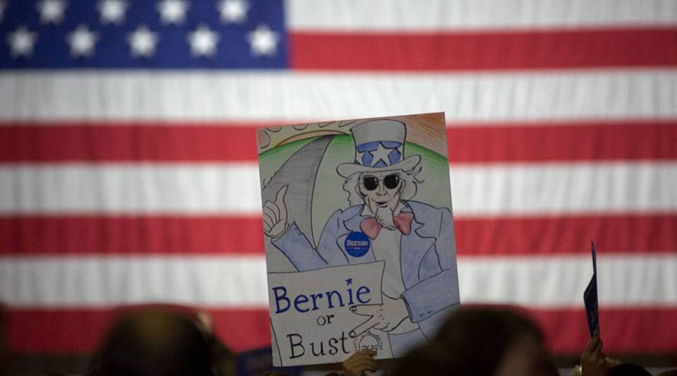 A man holds up a sign at the California primary election night rally for Democratic presidential candidate Senator Bernie Sanders in Santa Monica, California.Many Sanders supporters have answered the Senator's call and say they will vote for Clinton, but that support may not translate to donations.