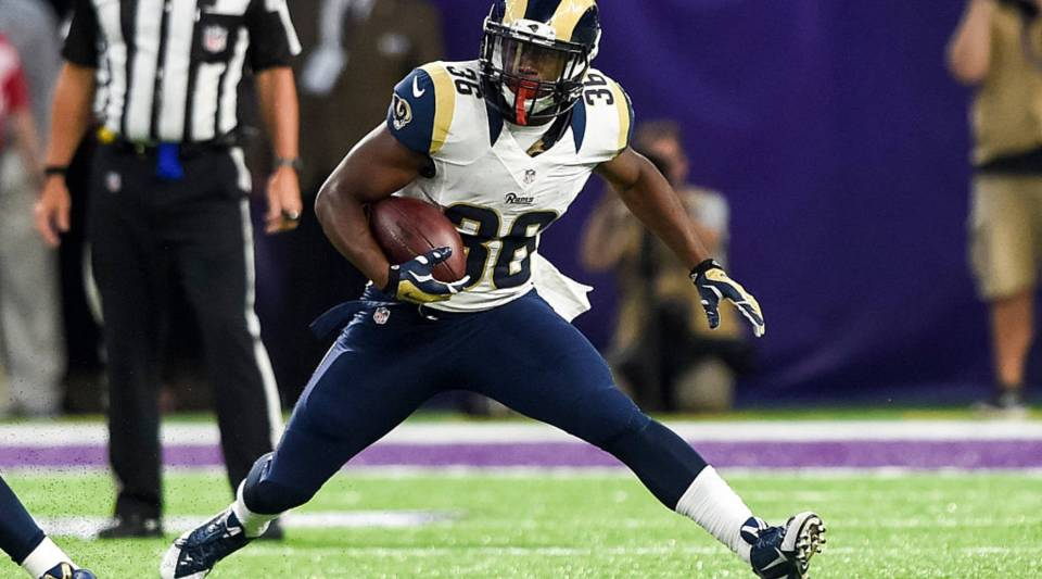Rohan Gaines of the Los Angeles Rams carries the ball during a game against the Minnesota Vikings on Sept. 1 in Minneapolis.