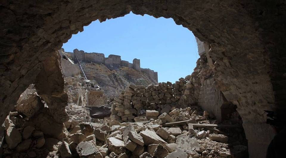 Aleppo's citadel is seen through destruction in this picture taken on September 28, 2016 in the Farafira district, northwest of the city's historic citadel, after Syria's army took control of the rebel-held district after days of heavy air strikes that have killed dozens and sparked allegations of war crimes.