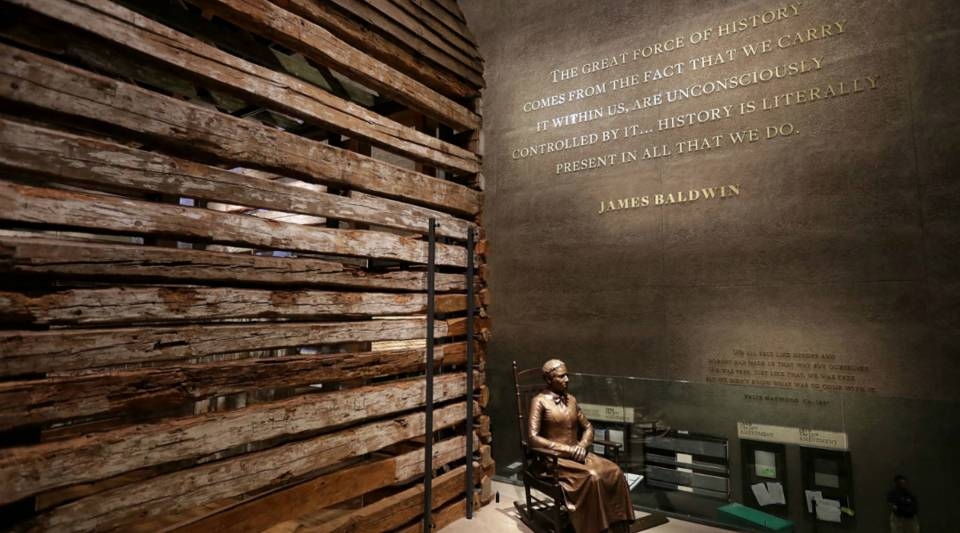 A statue of Colorado pioneer and former slave Clara Brown is on display next to a preserved slave cabin at the Smithsonian's National Museum of African American History and Culture.