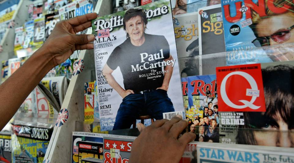 A vendor in Singapore pulls out an issue of Rolling Stone. A Singapore firm linked to one of Asia's richest families has bought a 49 percent stake in Rolling Stone to expand the U.S. magazine's business in new markets.