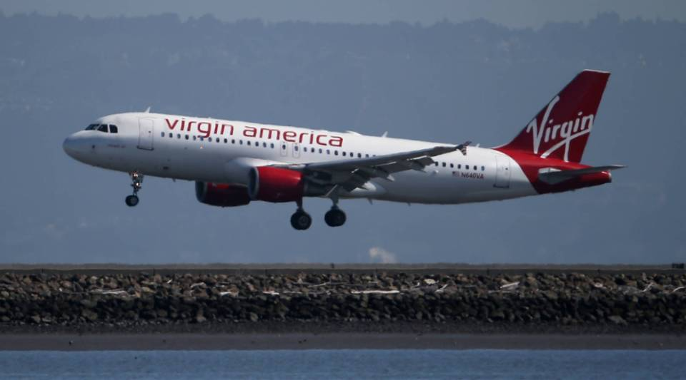 A Virgin America plane lands at San Francisco International Airport in Burlingame, California.