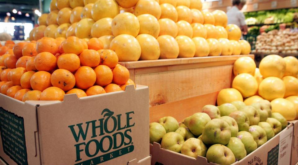 Fresh fruit is displayed at a Whole Foods store in Chicago, Illinois. The city is opening another Whole Foods store today in the neighborhood of Englewood.