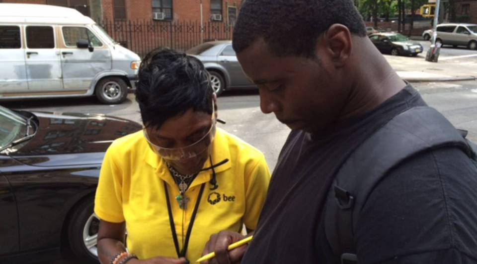 A Bee salesperson signs up a new customer in Harlem