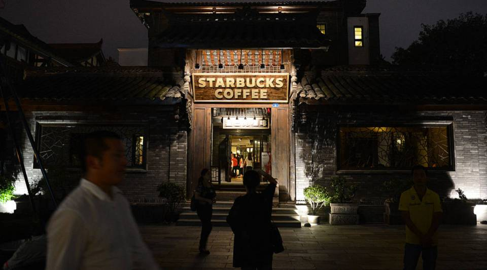 A Starbucks coffee shop, built in traditional Chinese style, in Chengdu, Sichuan Province, China.