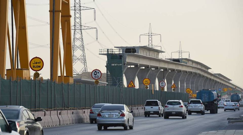 Vehicles drive past a construction site of a section of the Saudi capital Riyadh's $22.5 billion metro system. Many of Saudi Arabia's investment in public infrastructure projects, such as the metro, occurred just before a sharp decline in oil prices.
