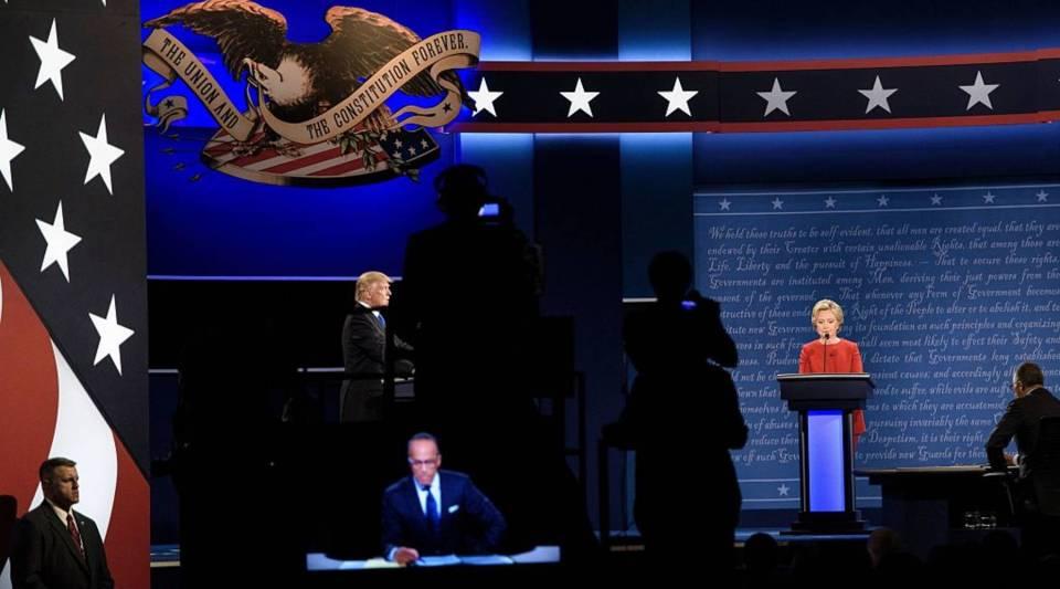 Republican presidential nominee Donald Trump (L) and Democratic presidential nominee Hillary Clinton wait to begin the first US Presidential Debate at Hofstra University September 26, 2016 in Hempstead, New York.