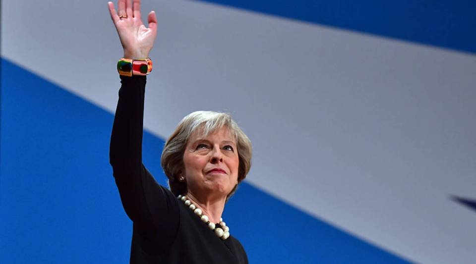 British Prime Minister Theresa May waves after delivering a speech about Brexit on the first day of the Conservative Party Conference 2016 at the ICC Birmingham in Birmingham, England.