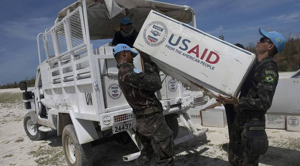 UN blue helmets load aid which arrived in US helicopters onto a truck for people affected by Hurricane Matthew, in Jeremie, southwest of Port-au-Prince, Haiti, on October 10, 2016. Haiti's death toll from monster Hurricane Matthew has risen to 372, civil defense officials said Monday, as the impoverished country continues to dig out of massive destruction in the south. More than 175,500 people were staying in temporary shelters, days after the Caribbean's worst storm in nearly a decade slammed into Haiti last Tuesday.