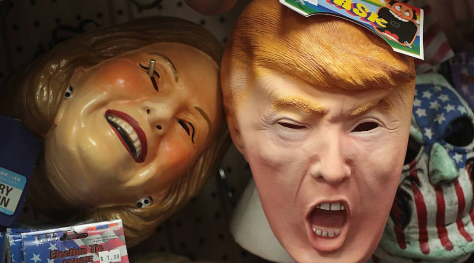 CHICAGO, IL - OCTOBER 19: Masks depicting Republican presidential nominee Donald Trump and Democratic presidential nominee Hillary Clinton are offered for sale at Fantasy Costumes on October 19, 2016 in Chicago, Illinois.