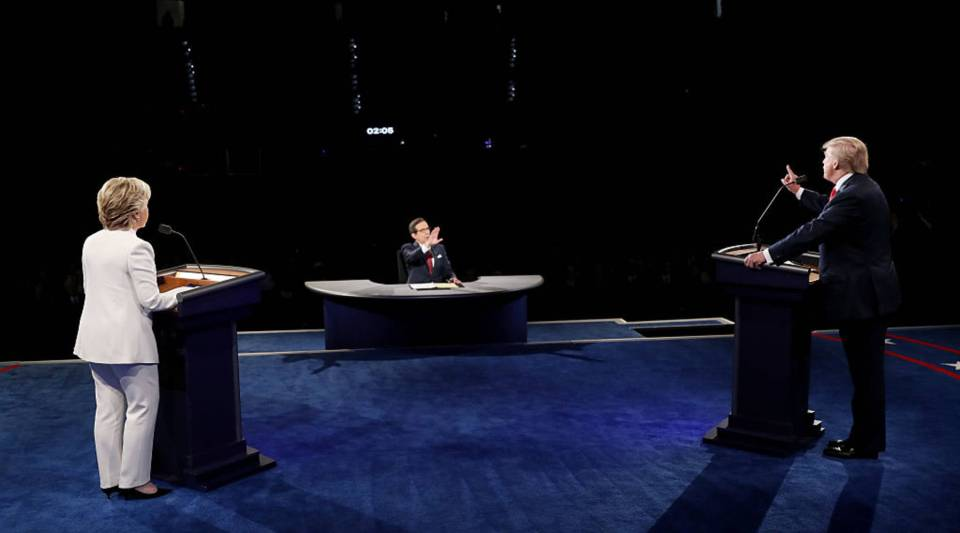 Republican presidential nominee Donald Trump (R) speaks as Democratic presidential nominee former Secretary of State Hillary Clinton looks on during the third U.S. presidential debate at the Thomas & Mack Center on Oct.19, 2016 in Las Vegas, Nevada.